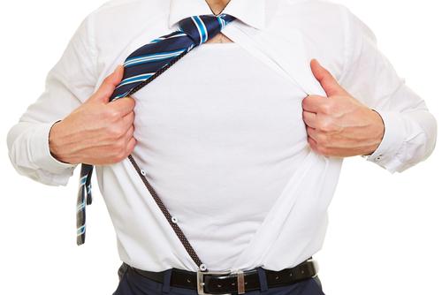 Business man showing a white t-shirt under his open shirt