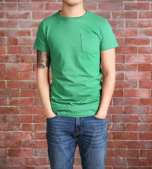 Young man in blank green t-shirt