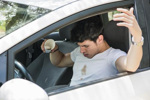 man in car spilled coffee shirt