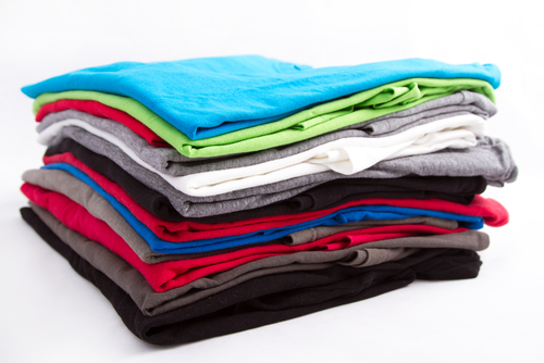 folded shirts stacked on each other