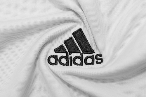the adidas logo on white fabric